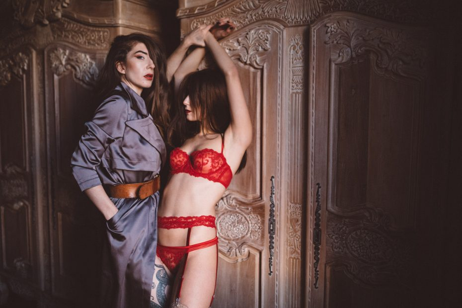 Bisexual girlfriends Alex Rayne and Louisa Knight in lingerie for a BDSM roleplay and threesome